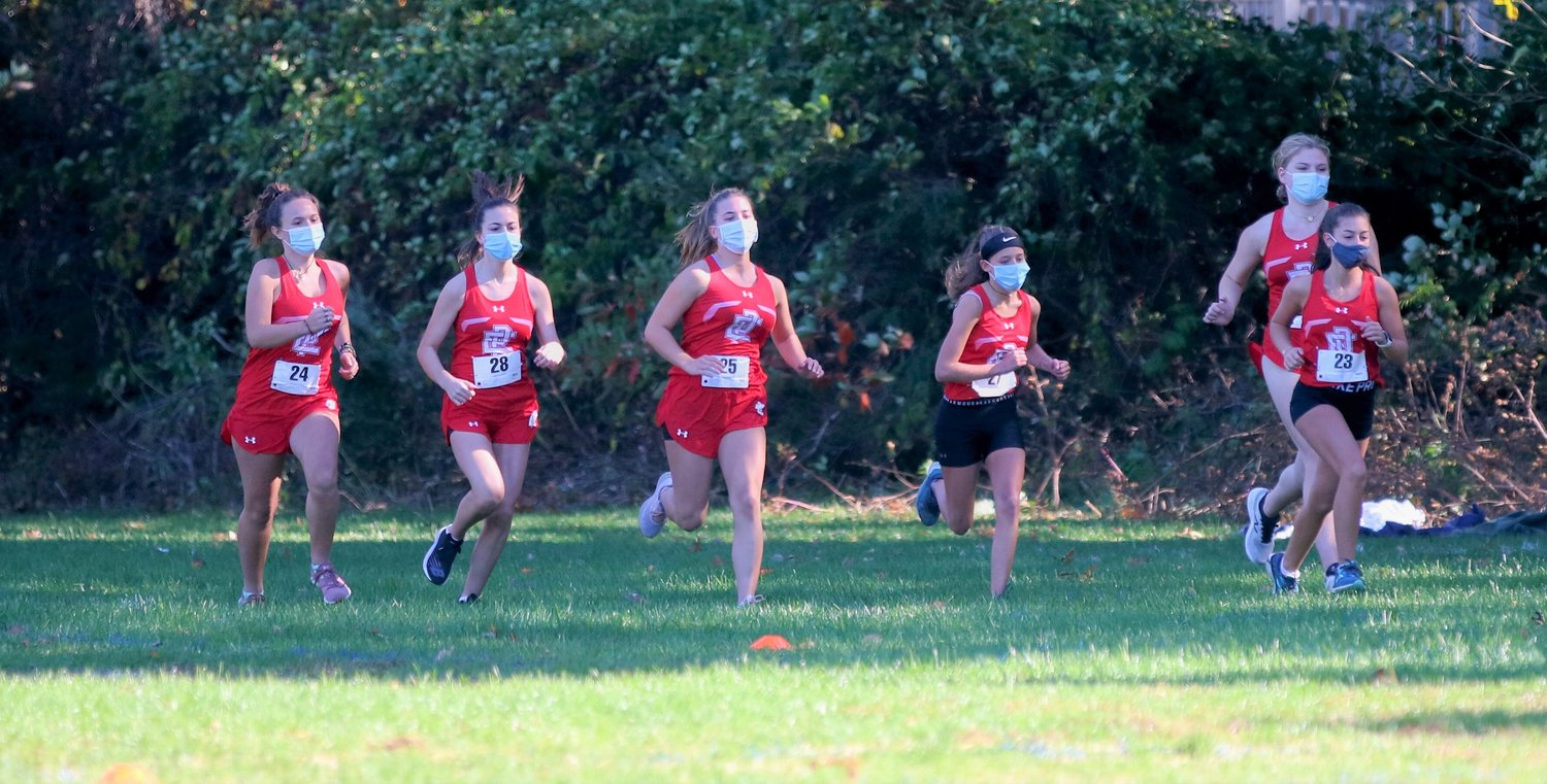 Townies girls cross-country team in action. Photo by Paul Tumidajski.