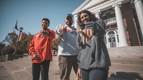 Tyler, Jim and Mya Lamonte pose for a photo in front of Boyden Hall.