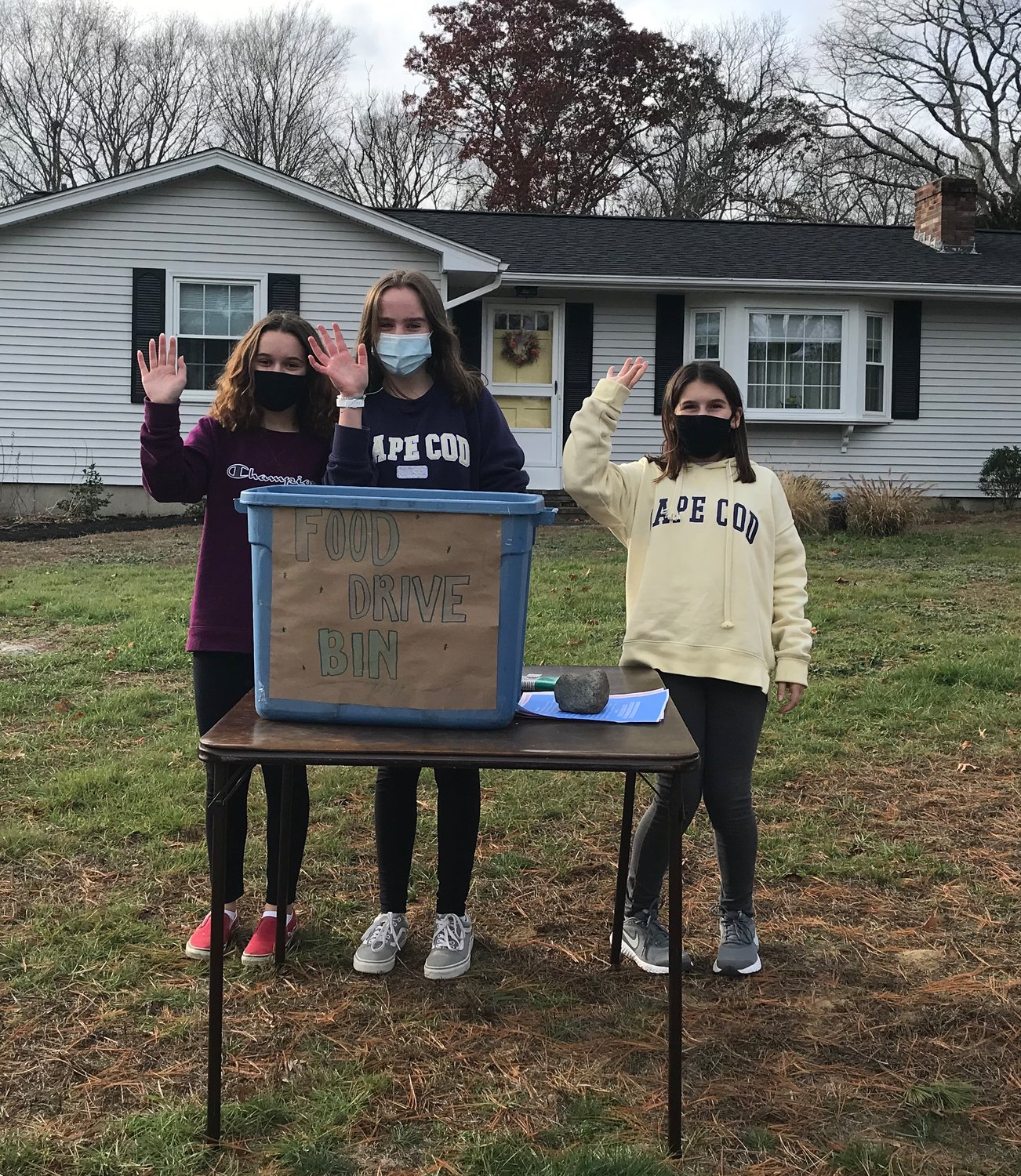 Hailey, Cadynce, and Cassidy hold Spread Kindness Food Drive