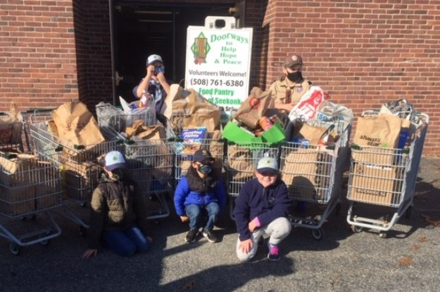 Scouts from Cub Scout Troop 88 collected a mountain of food