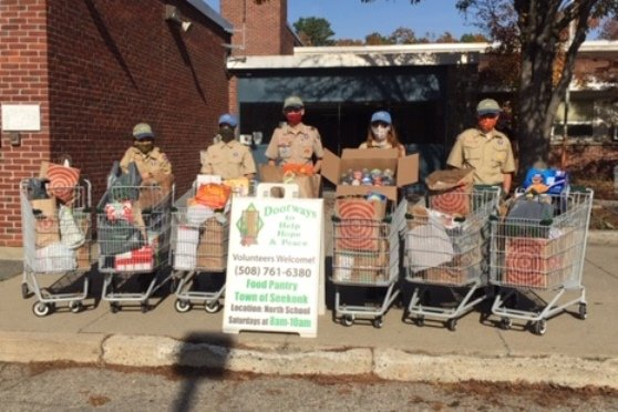 Some of the scouts from BSA Troops 1 & 9 pictured with a portion of their food drive