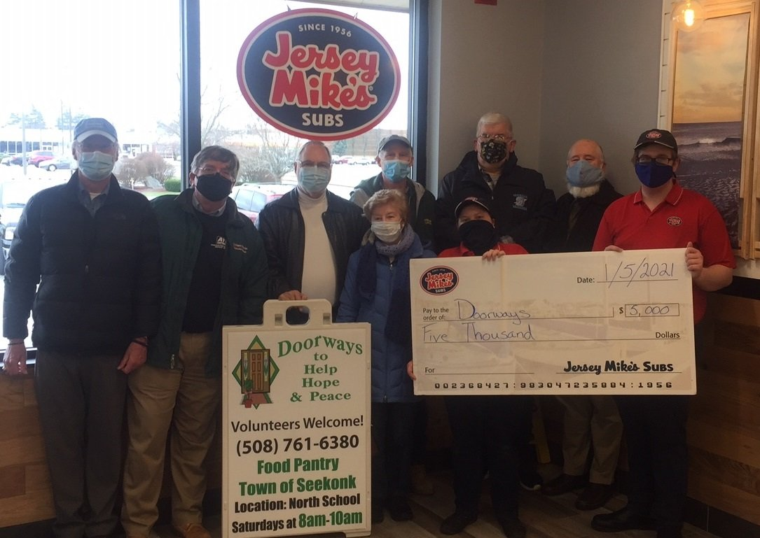 Jersey Mike's presents Doorways food pantry with a check for $5,000.00 