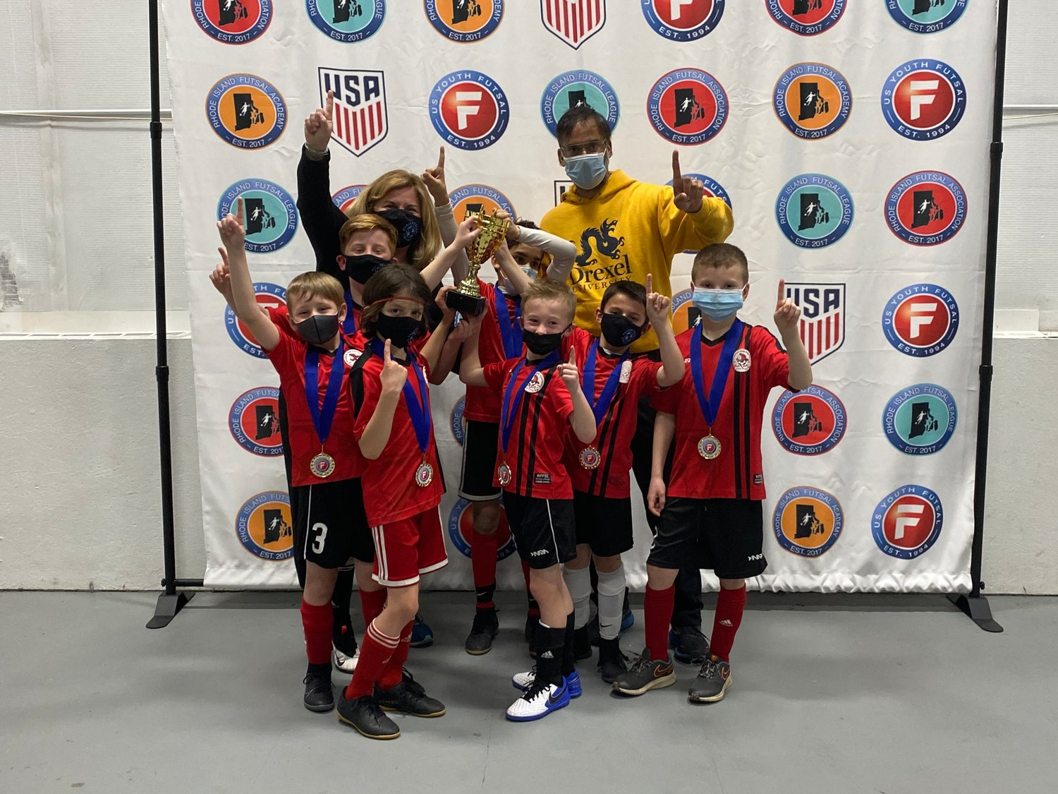Rumford resident Sean Masse and his teammates are all smiles after receiving medals at the Rhode Island Futsal League championship games.
