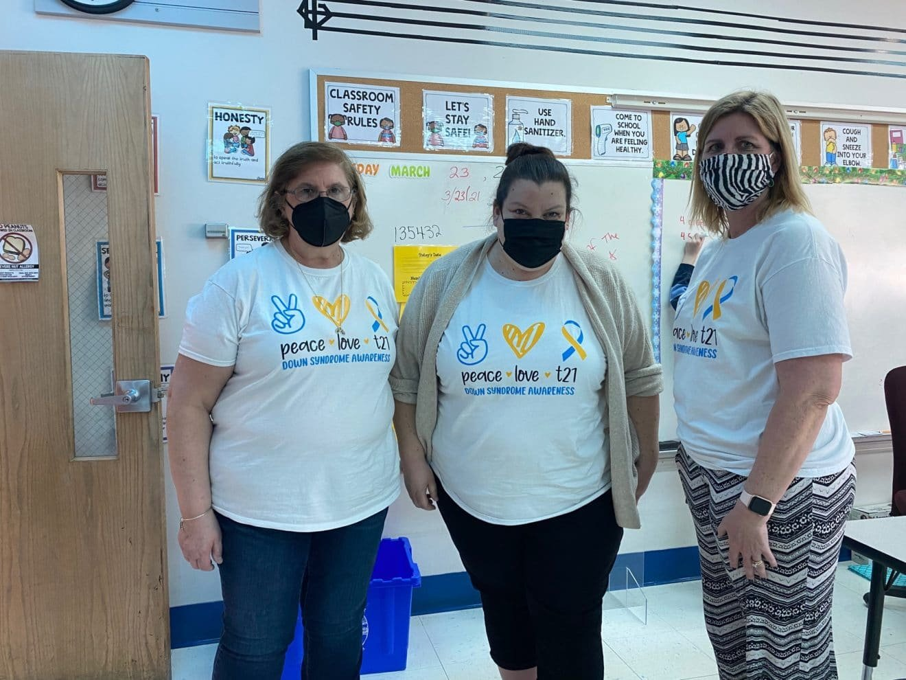 From left: Instructional Aide Sandy Matton, STARS teacher Becki Murray and Instructional Aide Patti Moniz participated in the 'Rock Your Socks Day' in recognition of World Down Syndrome Day.