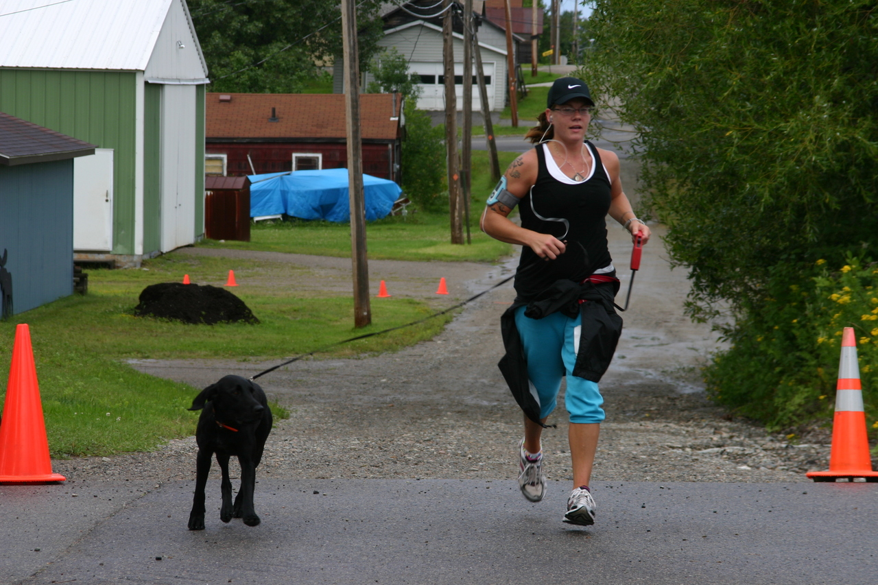 Beth Reichensperger crosses the finish line with a little help from a friend