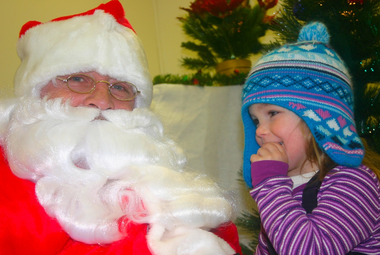Santa hears the Christmas wishes of a little girl during Orr's Snow City celebration.