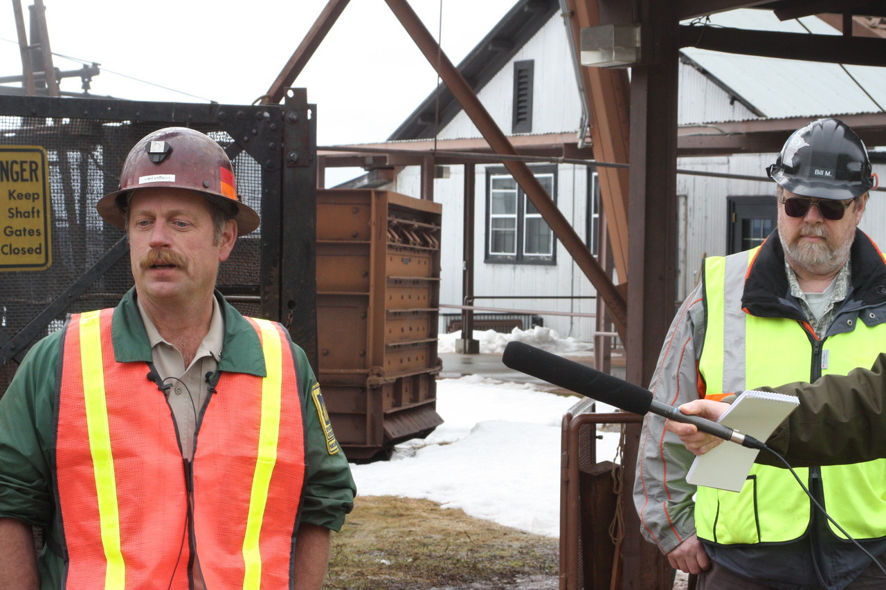 Park Manager Jim Essig answers questions during a press conference held at the park on Monday, while U of M Lab Manager Bill Miller looks on. The park remains closed until cleanup and a safety inspection have been completed.