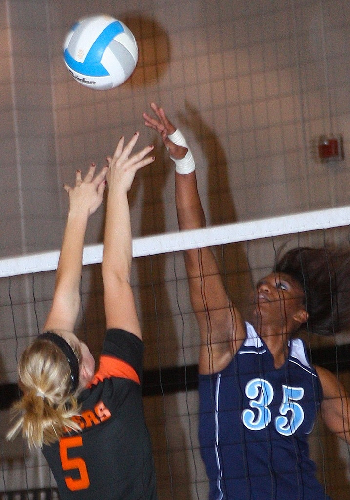 LaShae Brooks battles at the net.