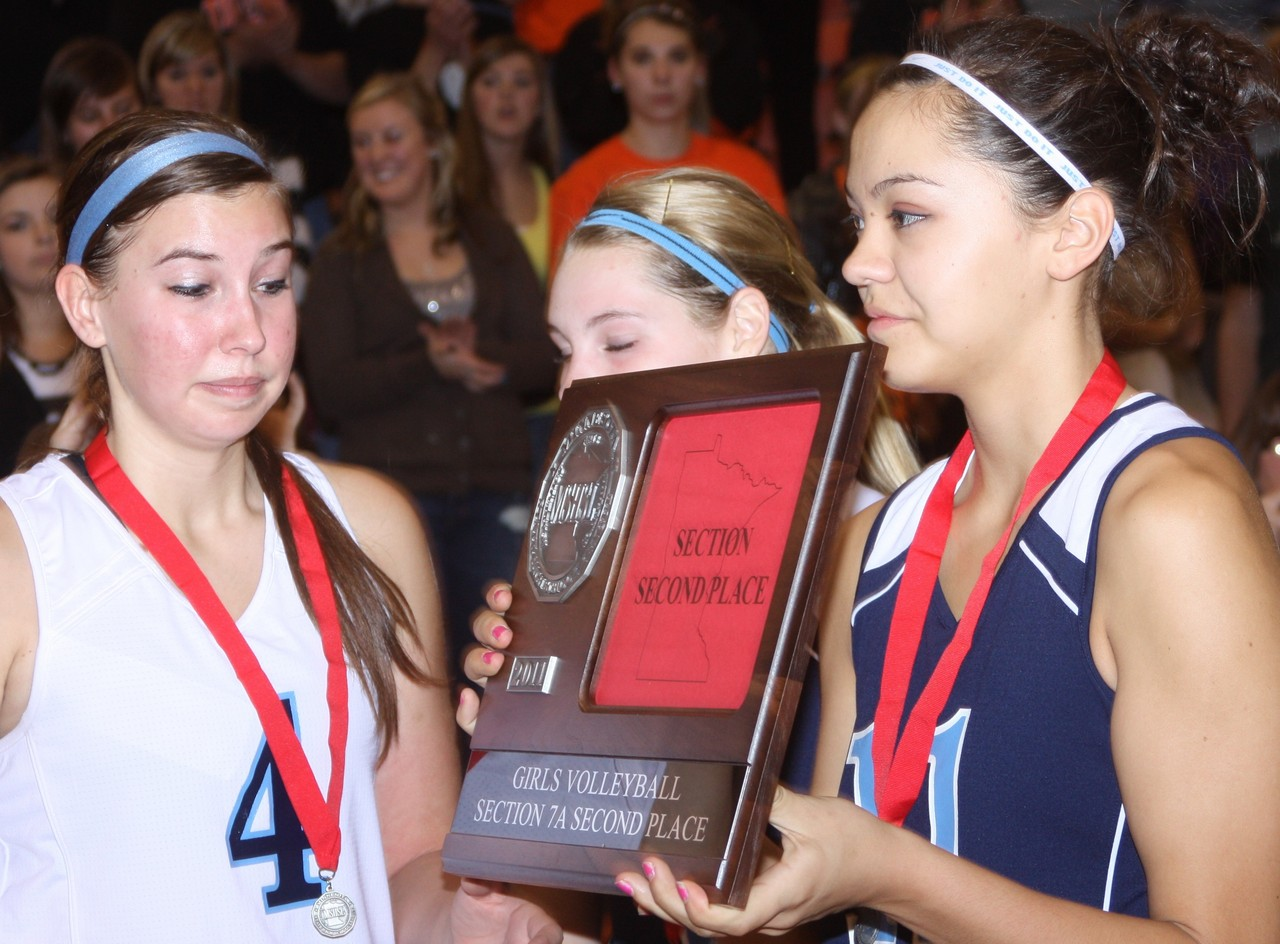 The Grizzlies' Katie Zallar, Tessa Mankus and Destinie Villebrun accept the team's plaque.