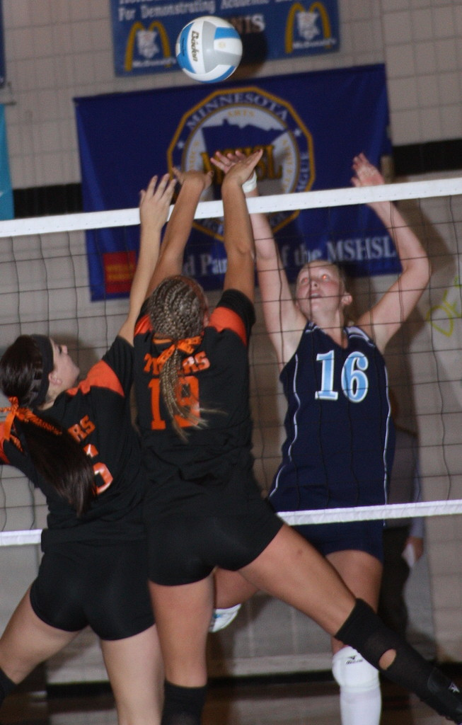 Darby Youngstrom faces a pair of Tigers at the net.