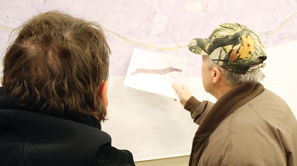 Ely residents Dean Erzar, left, and Chris Norman study the map of Highway 169 during a public 