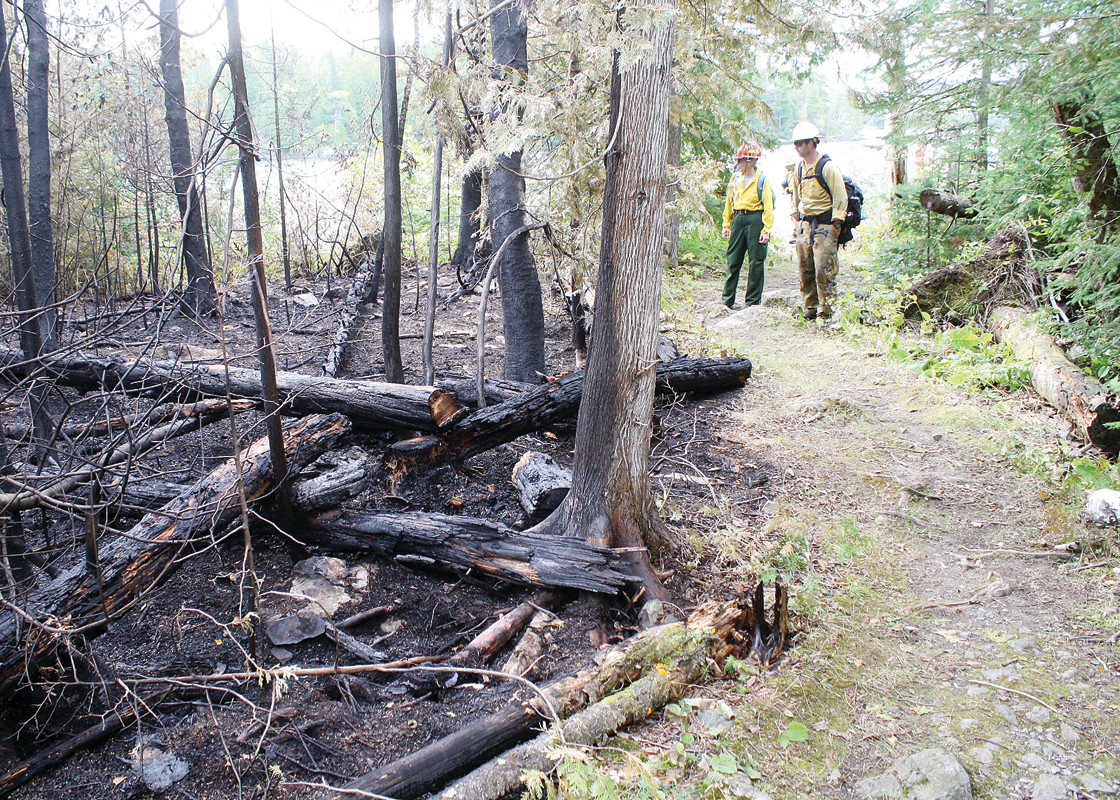 Superior National Forest firefighters survey the damage from the Knife Lake fire. The blaze burned 188 acres in the vicinity of the South Arm of Knife Lake in the Boundary Waters Canoe Area.