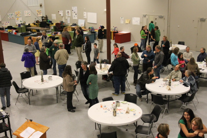 People gather during the dedication last Thursday, which featured short presentations and plenty of good food.