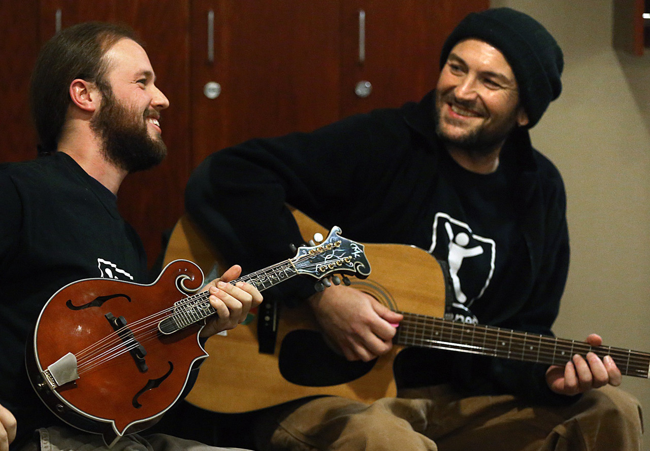Chris Henningsen (left) and Aaron Kaercher during their recent performance at the University of Minnesota-Fairview Medical Center, in Minneapolis, where Kaercher underwent a liver transplant with tissue donated by Henningsen.
