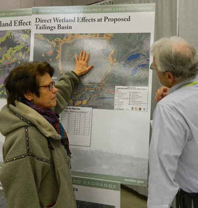 A member of the public asks questions about wetland impacts from the proposed mine during a recent open house on the SDEIS.