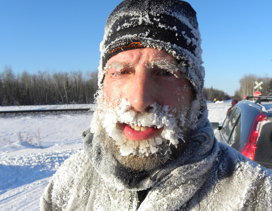 Minnesotan David Gray, smiles through an icy beard during a quick breather on the way. Gray finished fourth in the race, with a time of 25 hours, 57 minutes.