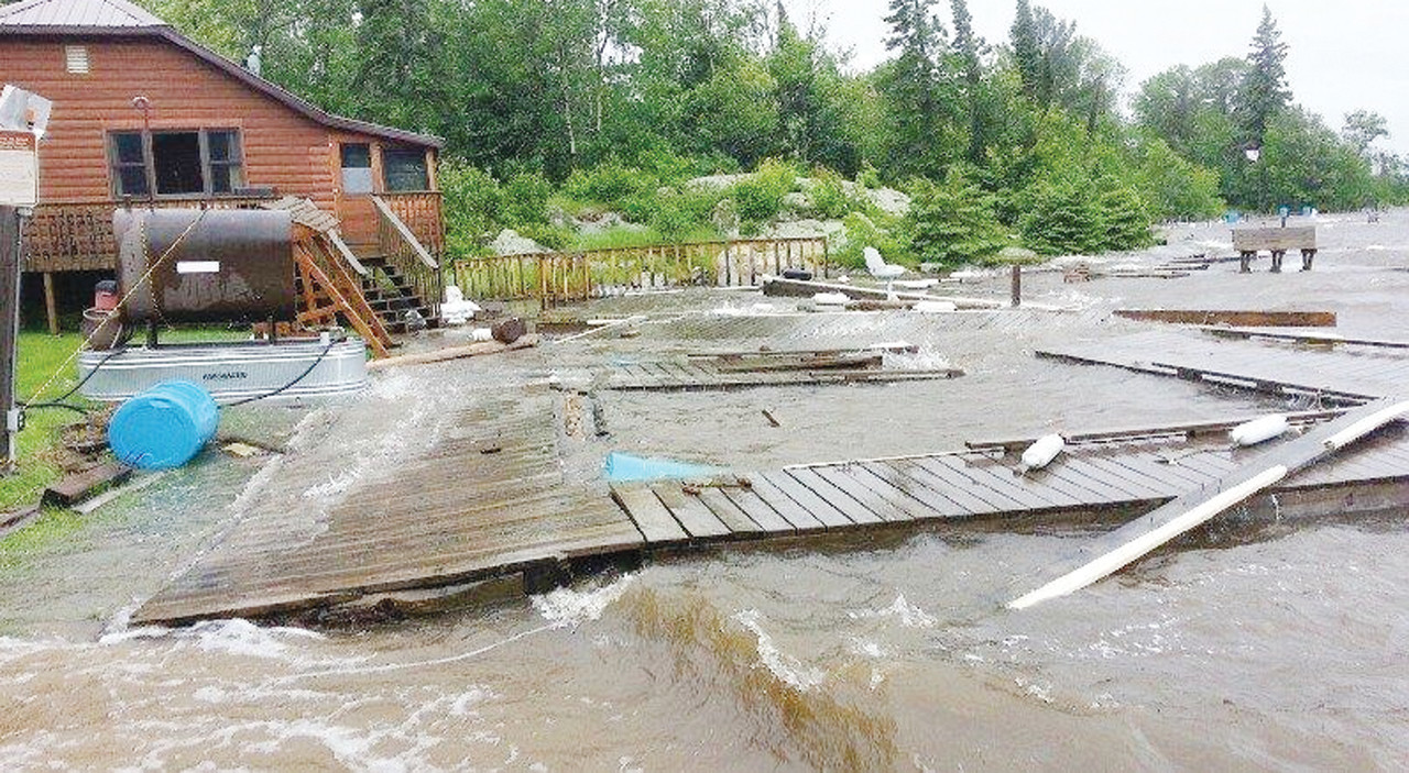 High water and powerful winds demolished the docks at Pine Tree Cove on Lake Kabetogama on Thursday. Resort owner Phil Hart estimated the damages at $80,000.