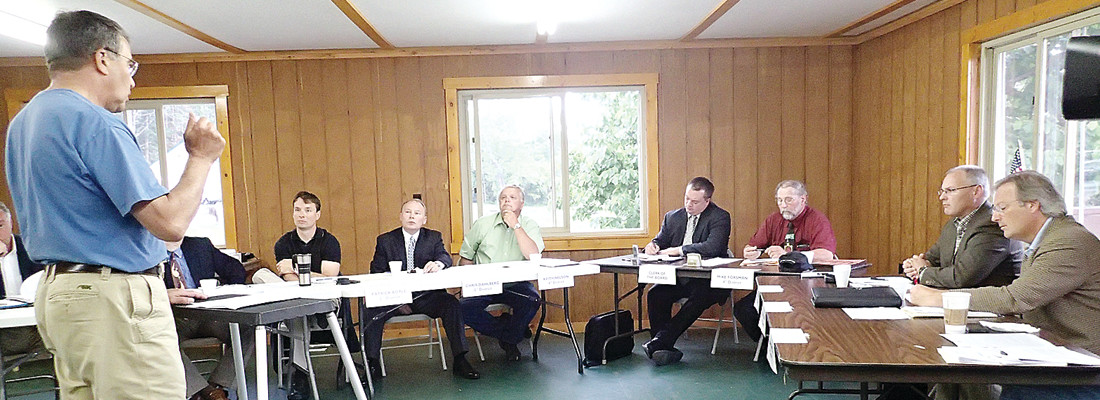 Mining opponent Reid Carron, above, addresses the St. Louis County Board of Commissioners Tuesday at Semers Park Pavilion in Ely.