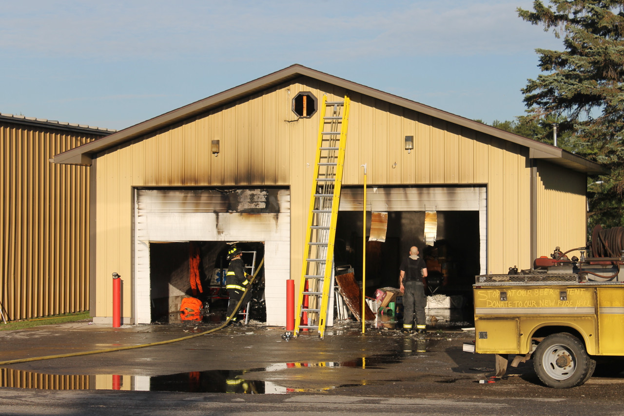 Charring is clearly visible on the front of a Tower Fire Department storage building, following an early morning fire.