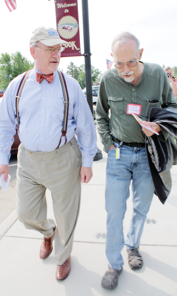 Ed Ehlinger, Minnesota Health Commissioner, left, walks with Cook Mayor Harold Johnston during a visit to Cook earlier this month to promote community investments in health.