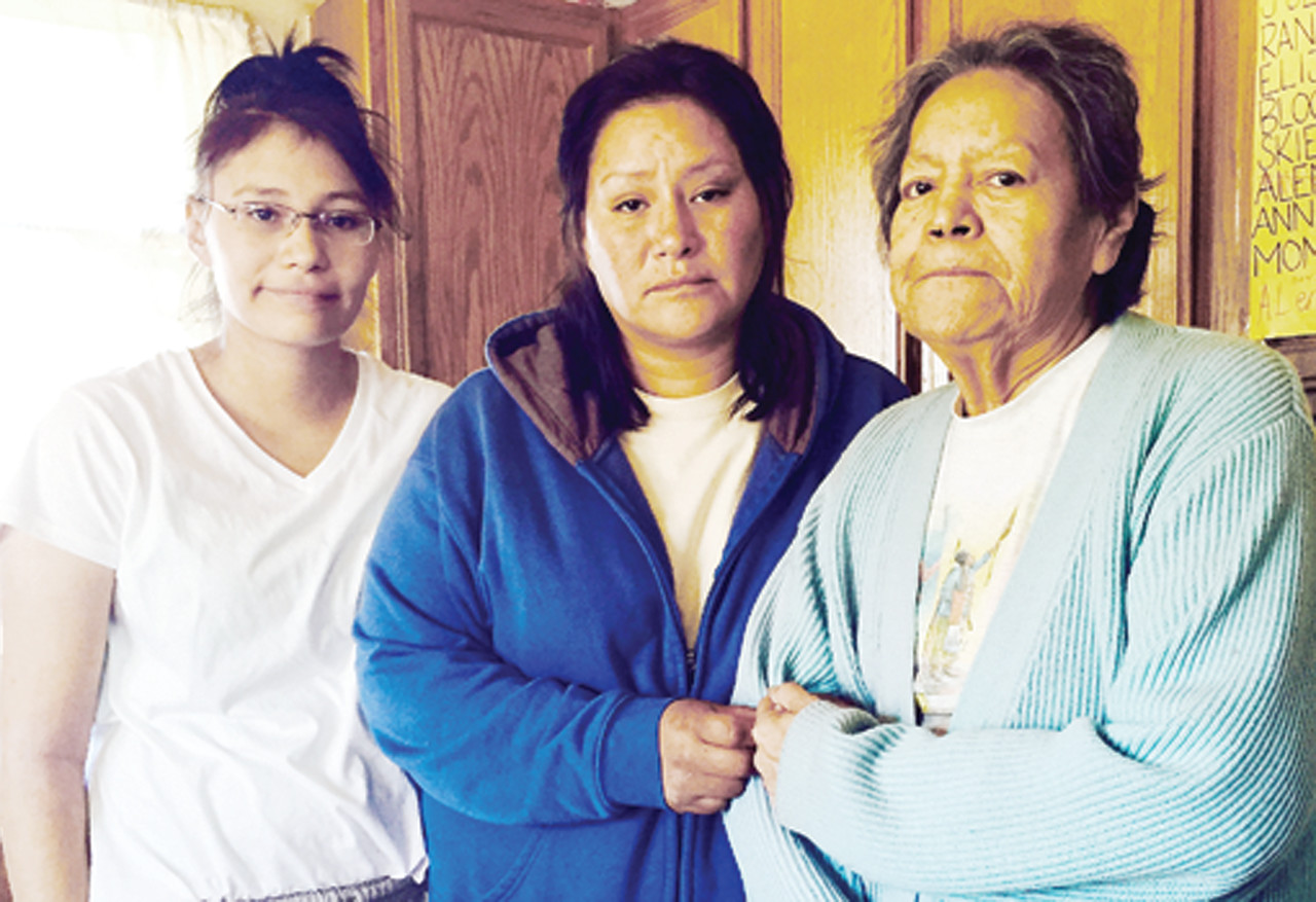 Edith Chavez, center, with daughter, Alena, and mother, Jackie, at home on the Vermilion Reservation, just days after her abduction ordeal in North Dakota.