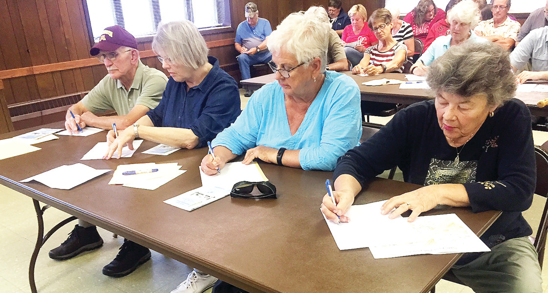 Mary Batinich, right, and other Tower residents write down their ideas at a vision session organized by the Tower Main Street Committee.