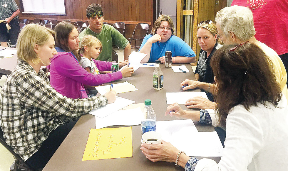 A visioning group discusses ideas at a recent meeting of the Tower Main Street Committee.