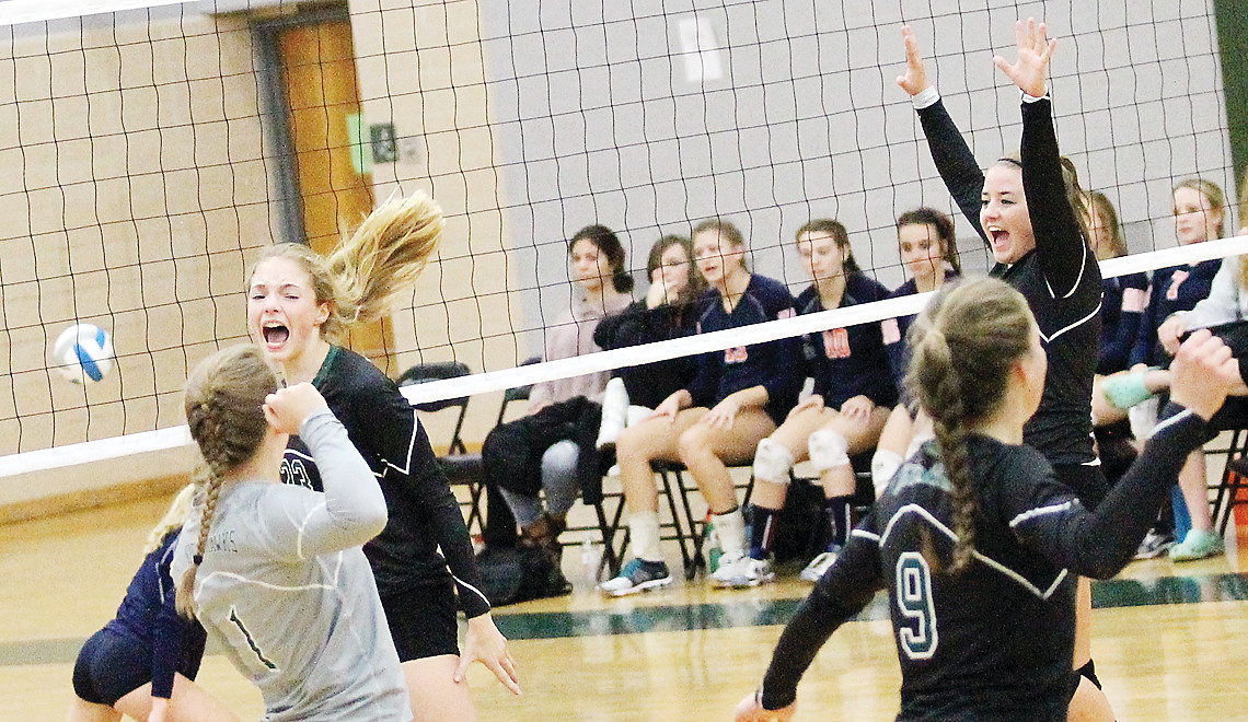 ­Northeast Range's (from left) Lyric Johnson, Rebecca Nelmark, Hannah Reichensperger, Sophie Lenz and Maree Poppenhagen react after a powerful kill in Tuesday's home win.