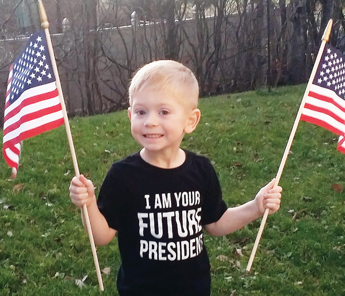 Braylon Carlson, 4, of Tower, was in election mode on his way to preschool Tuesday.