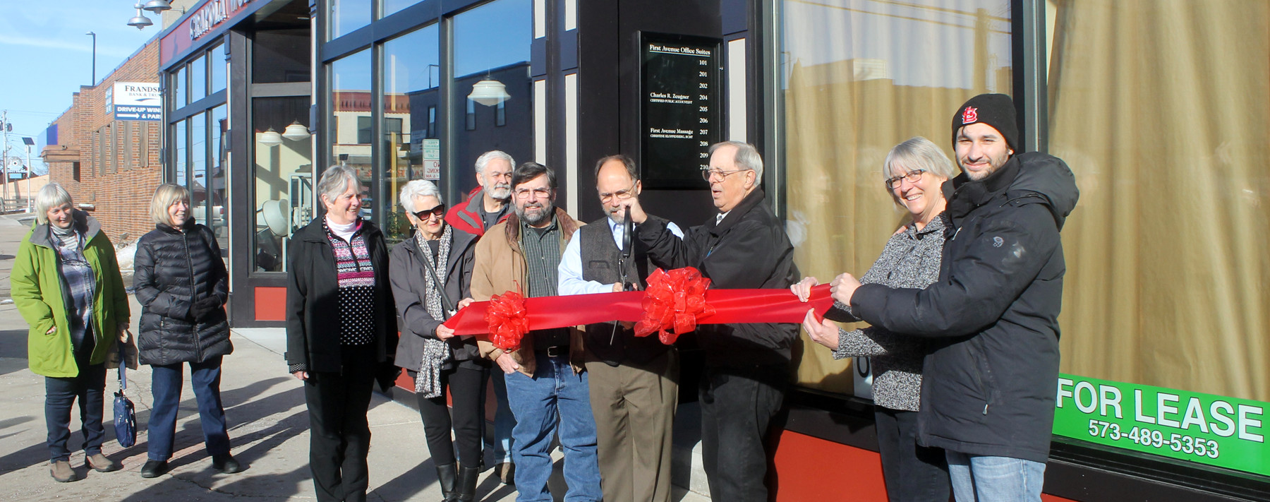 A ribbon-cutting celebration in front of the James Drug Building in downtown Ely was recently held for Chuck Zeugner's  new certified public accounting business. The efforts of Alley A Realty, including Tanner Ott, shown far right, and his father, John, are at the forefront of an economic develpment renaissance in the community. photo by K. Vandervort