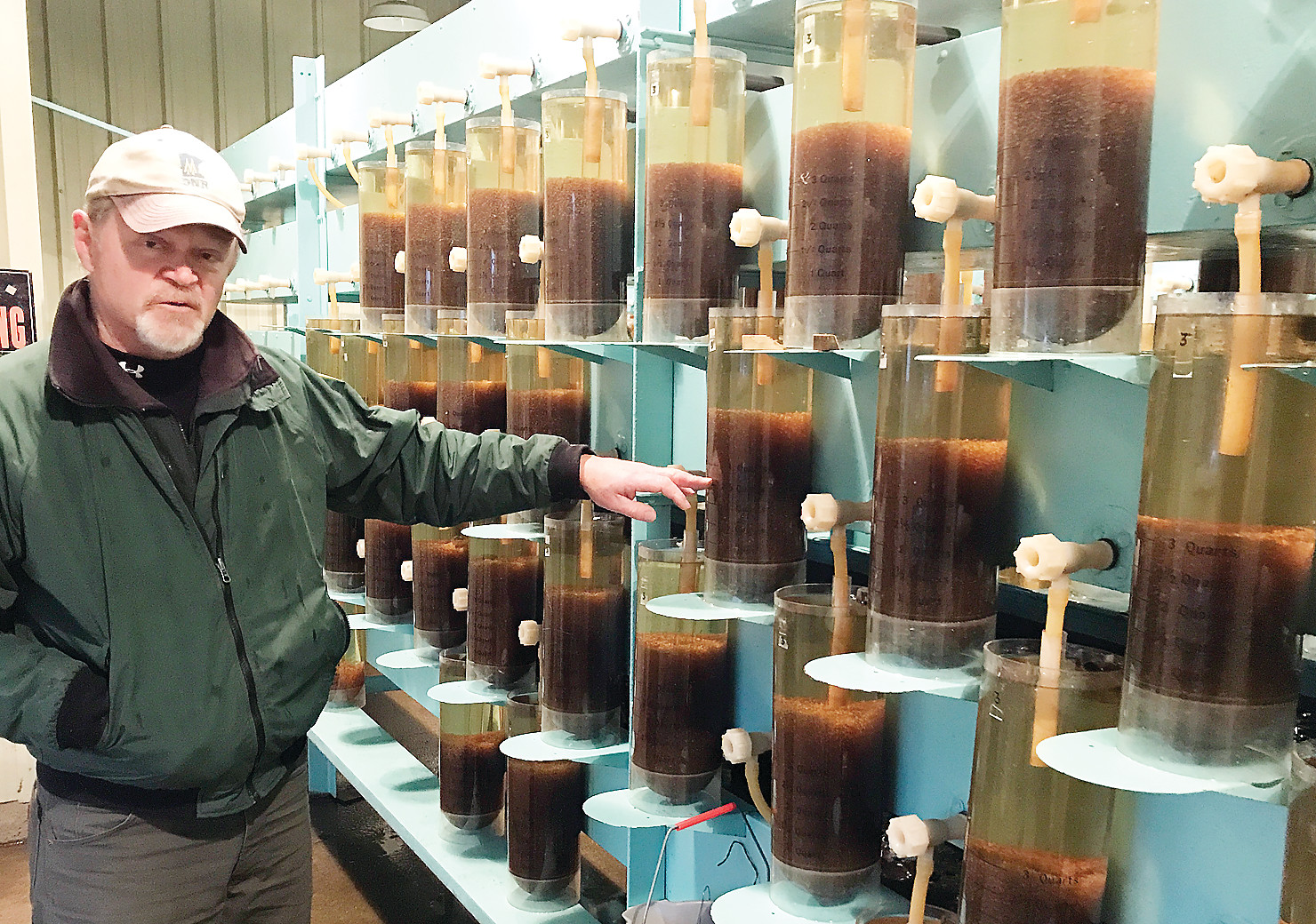 Pike River Hatchery Manager Jeff Eibler checks on incubating walleye eggs. The eggs should be hatching in a week to ten days.