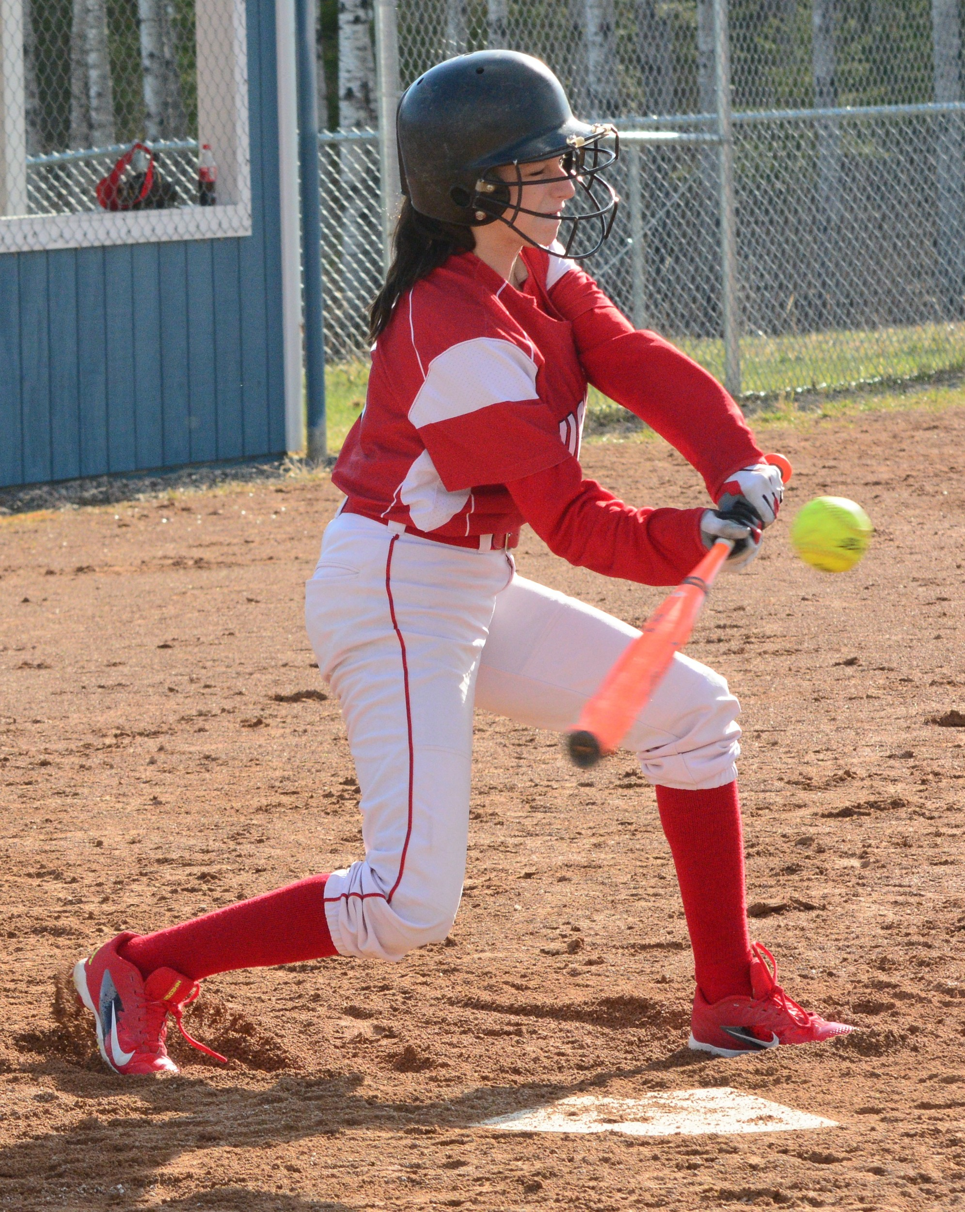 Ely's Savannah Johnson connects with a pitch in Thursday's game.