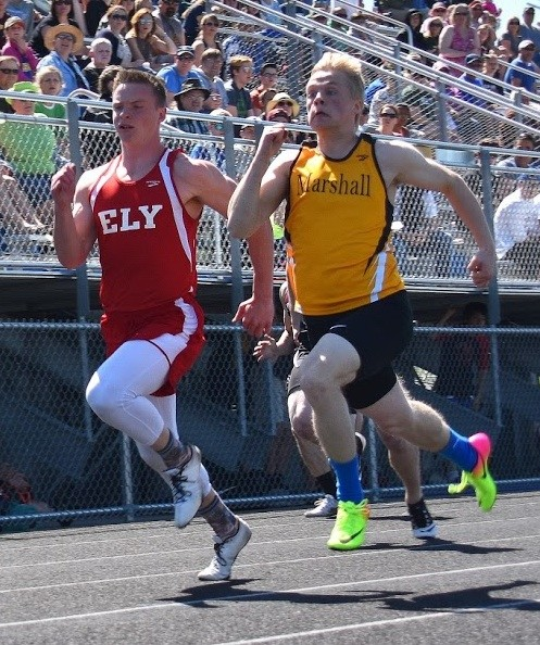 Ely senior Josh Heiman runs neck-and-neck with a Duluth Marshall foe during the 100-meter dash during Thursday's Section 7A meet in Duluth. Heiman qualified for state in the 100, as well as the long jump and the triple jump.