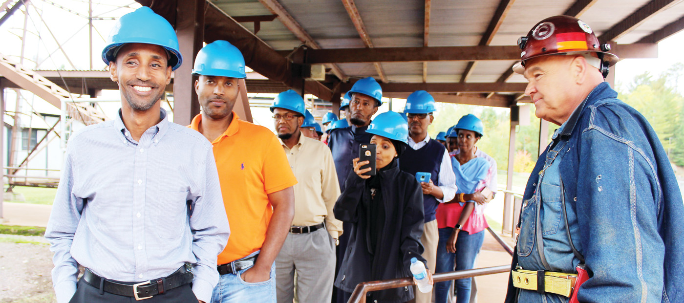 "Somali visitors from the Twin Cities toured the Soudan Underground Mine during their first trip ""up north."" Park guide Karel Winkelaar (right) helped organize the visit."