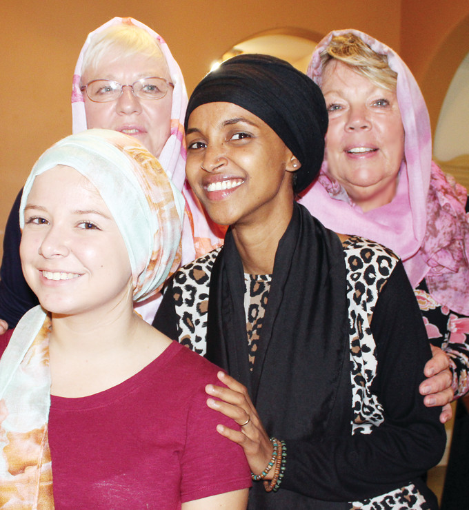 Rep. Ilhan Omar and other trip organizers presented gifts of traditional Somali head scarves to the hosts at Sulu's, (from left) Bria Chiabotti, Linda DiCasmirro, and Brenda Winkelaar.