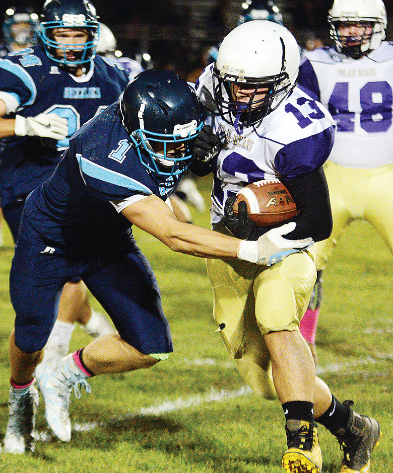 Grizzlies junior tight end Chase Kleppe takes down Floodwood senior Cameron Goutermont.