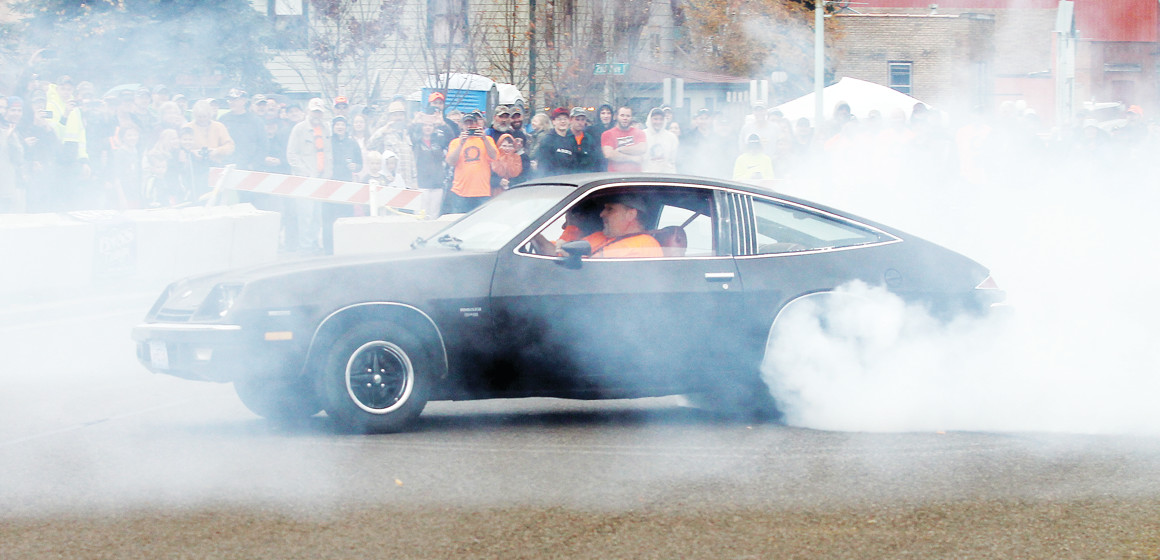 Ely resident Albert Forsman burns the rubber off the tires of his 1975 Chevrolet Monza 2+2 hatchback Saturday at a memorial scholarhip funding event for his son, Jake, who died following a vehicle accident a year ago.