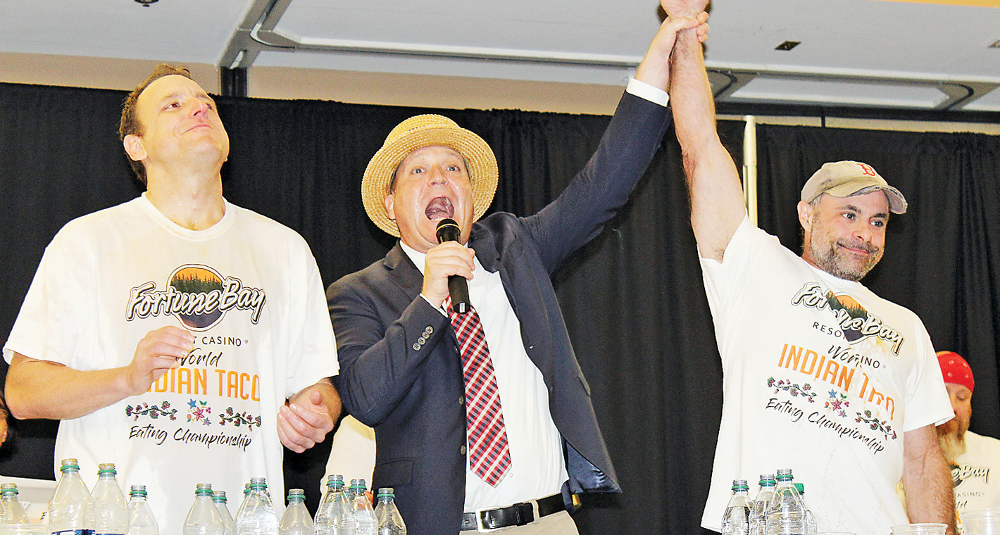 Sam Barclay, emcee of Major League Eating, announces Geoffrey Esper as the winner of the Indian Taco eating contest Saturday night at Fortune Bay Resort Casino. The fourth-ranked Esper beat Joey Chestnut, who holds 43 MLE world records.