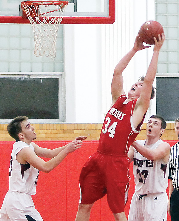 Blaise Lah comes down with one of 14 rebounds he tallied in Ely's season opener.