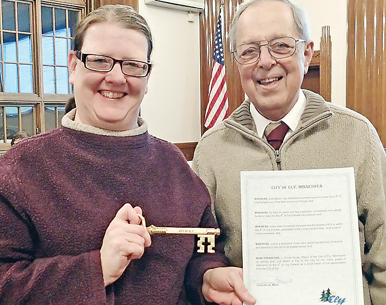 Jodi Martin receives a Key to the City from Mayor Chuck Novak for her 20-plus years of service to the city of Ely, organizing the annual Fourth of July parade.