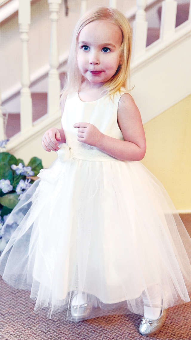 Cecilia Vanni Trucano Majerle, 3, of Tower, poses in a custom-designed flower girl dress by Beth Ohlhauser of Olive and Fern, organic and nature inspired dresses, located in Ely.
