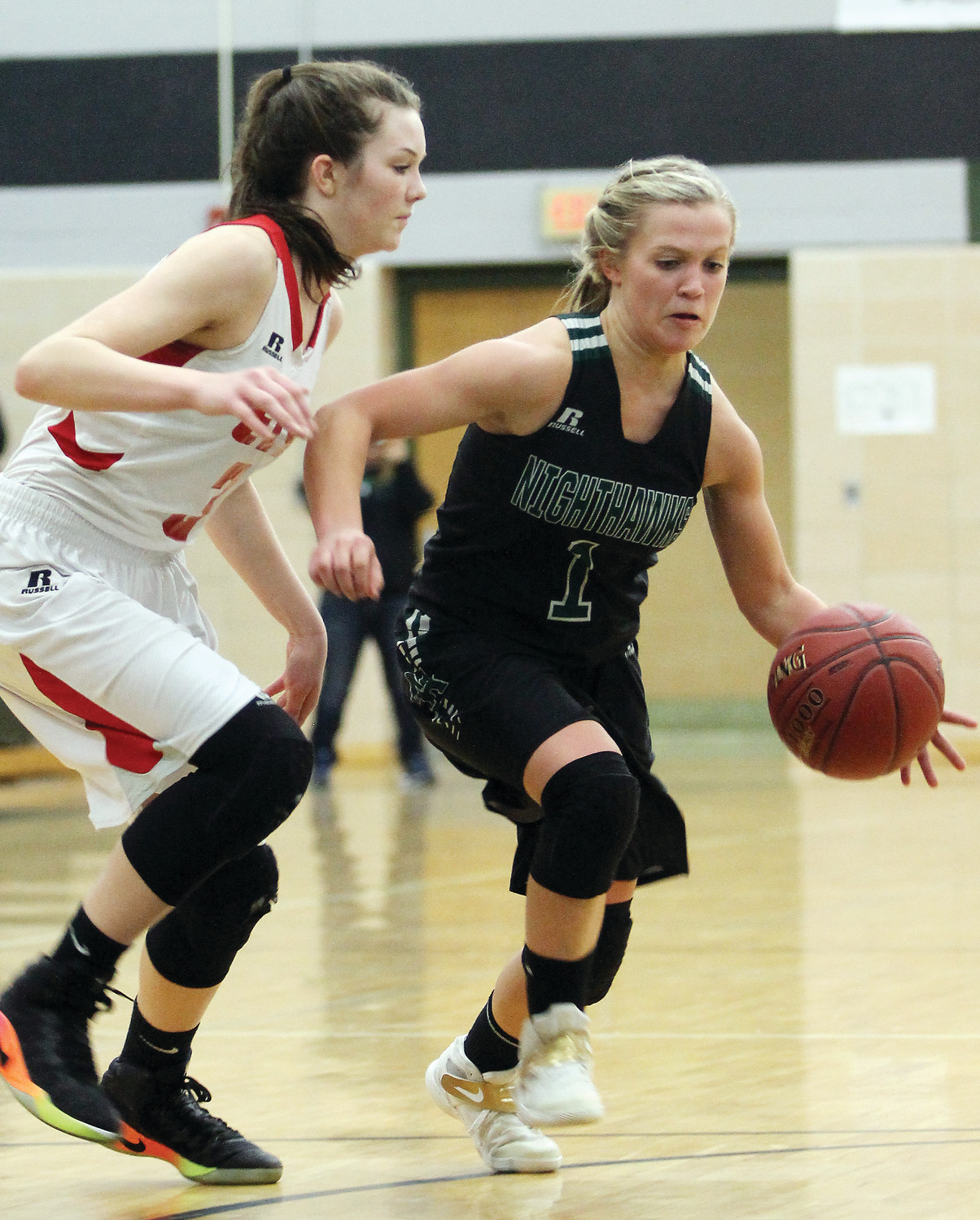 Northeast Range's junior guard Shayler Lislegard advances the ball under pressure from Ely's Brielle Kallberg.