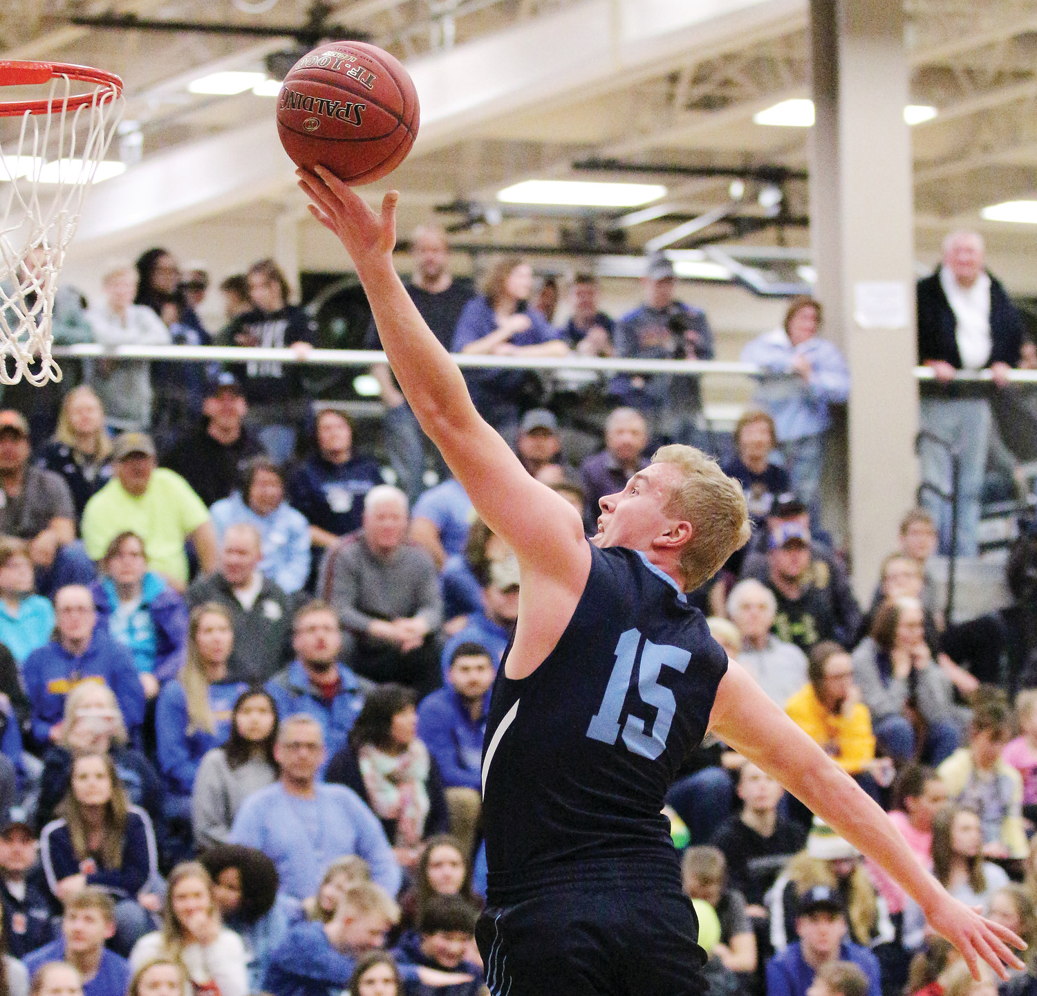 Grizzlies senior Tate Olson goes in for a layup during last Friday's game against Deer River. Olson scored his 1,000th point during the match.