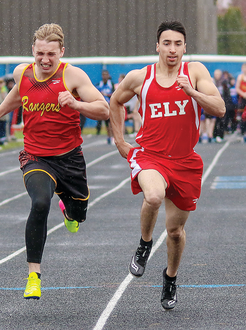 Ely's Isaac Gawboy nears the finish line as he took first in the 100-meter dash.
