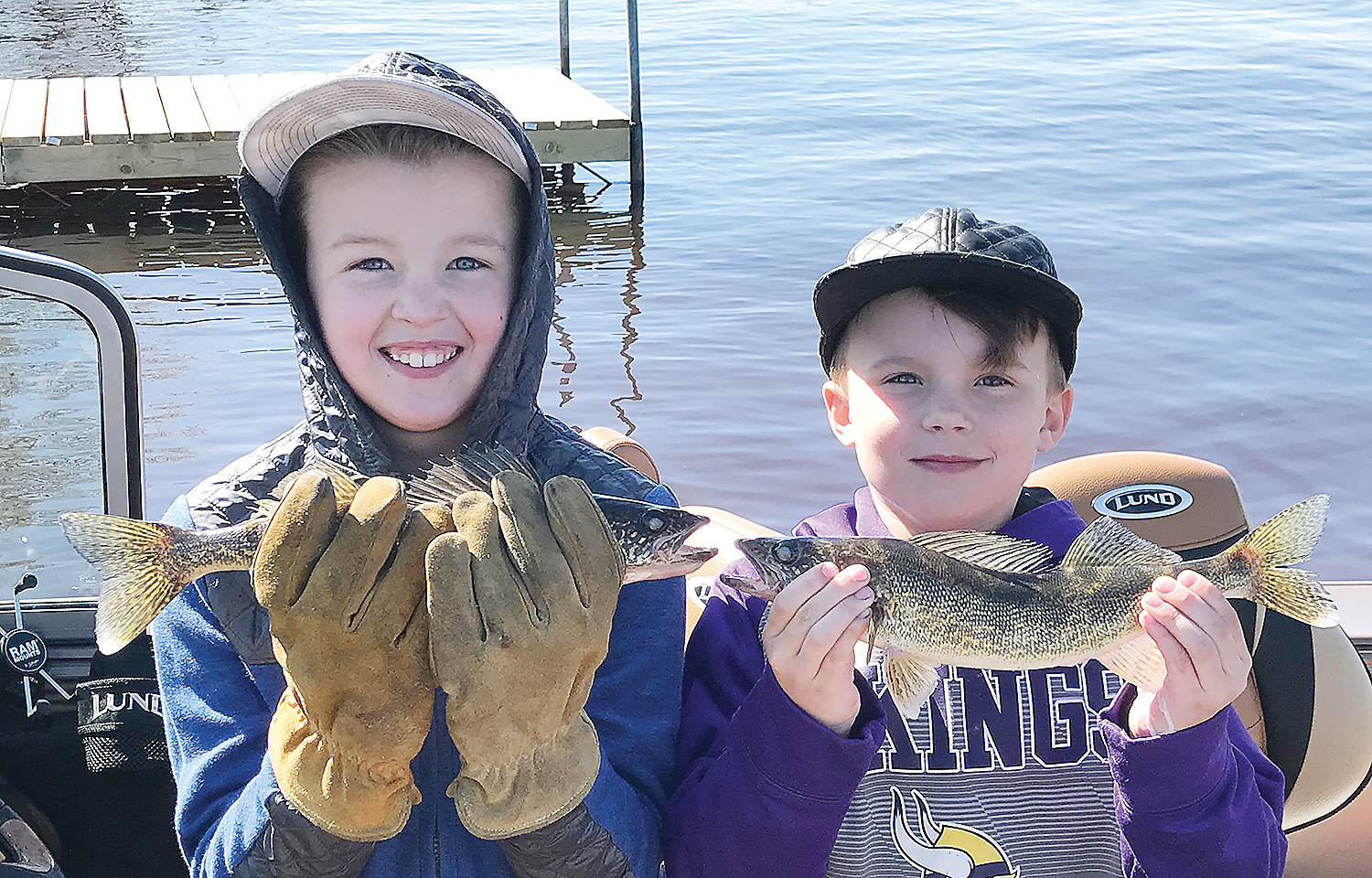 Grant and Jack Aysta, of Eveleth, were having a great time fishing with their dad and his friends on Lake Vermilion.