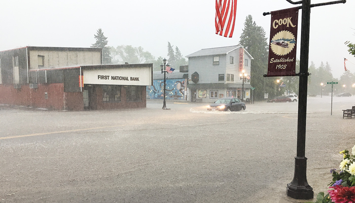 Streets in the city of Cook were flooded on Saturday following an intense rain storm that dumped as much as a half-foot of rain inless than an hour.