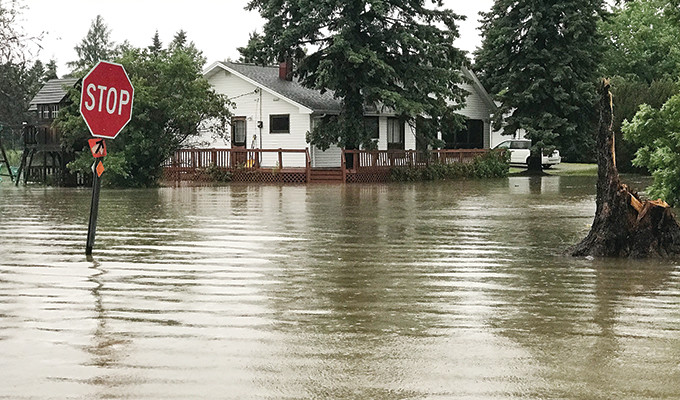 An intersection in Cook was under about three feet of water for a time on Saturday.