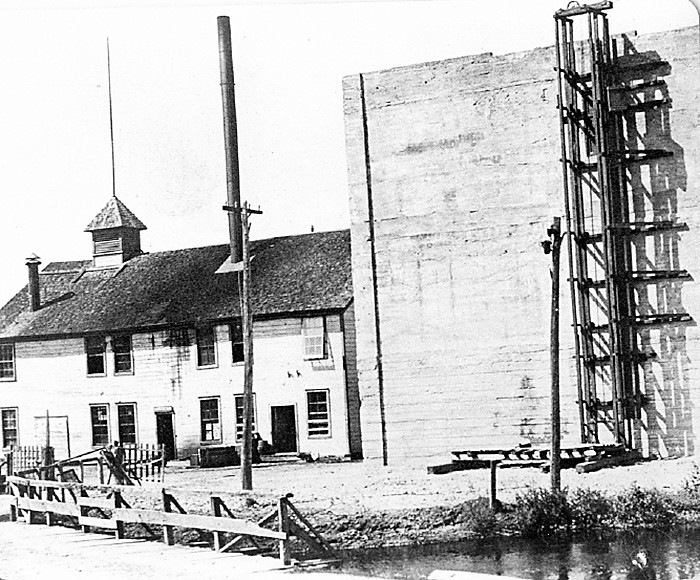 The former brewery seen from the outside. The wooden structure is gone, but the heavy concrete cooling house remains today and was the home of the Iron Ore Bar for many years.