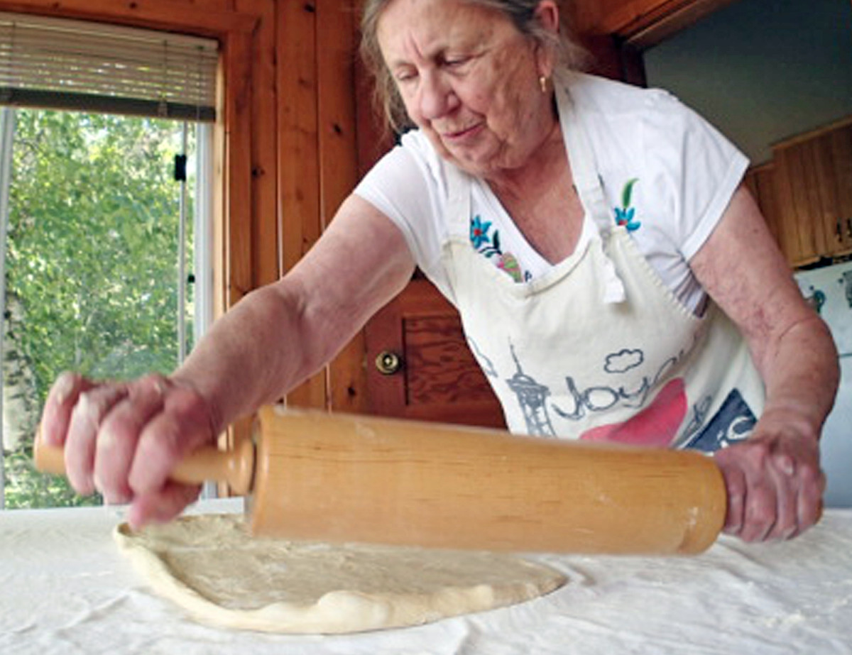 Mary Louise Icenhour begins the arduous task of  rolling out the dough for her potica.