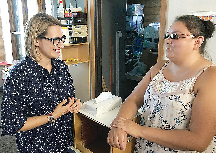 State Representative and DFL Lt. Governor candidate Peggy Flanagan talks with Bois Forte Head Start site manager Amber Wilke during a visit to the facility on Monday.